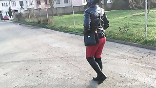 Fetish wife in the city - down PVC jacket with hood, leather leggings, gloves and boots