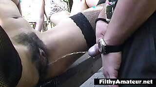 Crazy outdoor orgy with pissing on pussy
