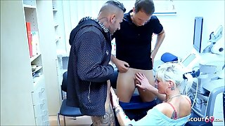 German MILF Nurse tricked to Threesome by 2 Guys in Clinic