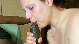 Nasty Mystic ginger sucks a black cock
